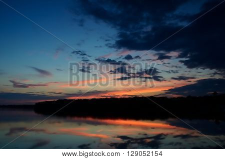 Sunset Reflections on Linwood Lake Minnesota with Clouds