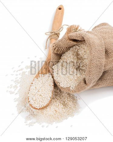 White uncooked rice spilling out of a small burlap sack isolated on white background