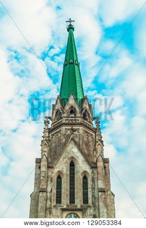 Old Historical Cathedral with Green Roof,Blue Sky,Toned