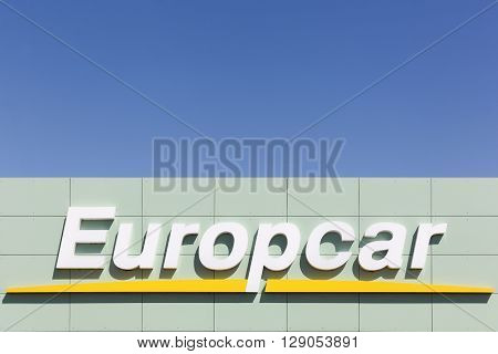 Aalborg, Denmark - May 9, 2016: Europcar logo on wall. Europcar is a French car rental company founded in 1949 in Paris