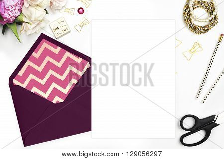 Feminine scene. Glamour style. Gold and stationery items on white table. View up. Flat lay. Wedding template invitation. Place your text or your artworks. bouquet of flowers, peonies with the tulips. Feminine scene. Glamour style. Gold and stationery item