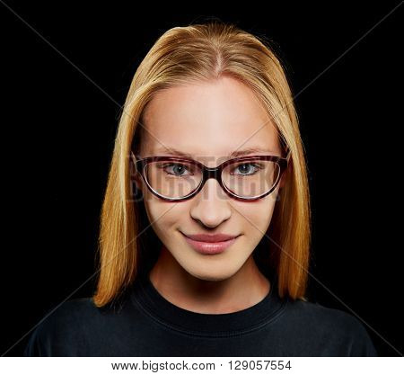 Young blonde woman smiling with nerd glasses