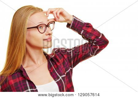 Young pensive woman having doubts while thinking and looking into the distance