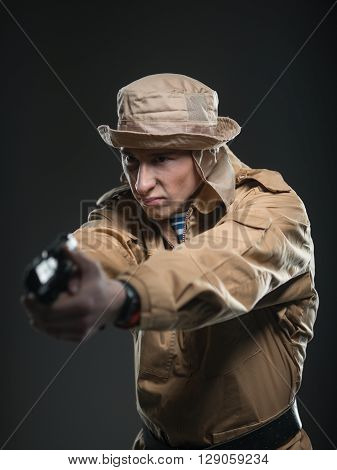 Soldier With A Gun On Dark Background