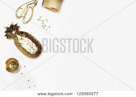 Gold woman items on table. Feminine scene glamour style. White background mock up. Flat lay party desk. Table view workspace. Pineapple gold bag Golden shears confettis.