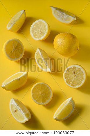 Fresh lemon slices on yellow background