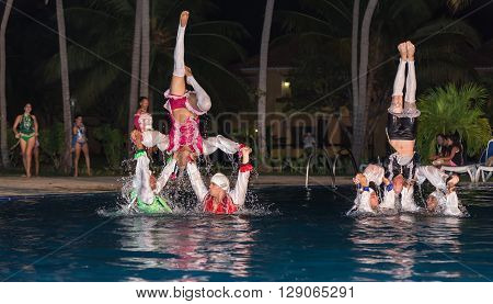 Cuba, Aug 10, 2014, Amazing beautiful stylish water show performed by a high passionate professional Cuban dancers at night swimming pool