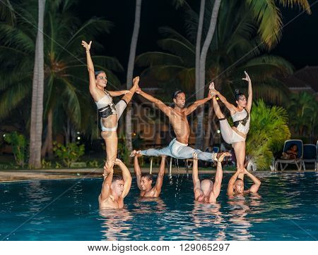 Varadero island, Rock Arenas Dora-dos, Cuba, Aug 10, 2014, nice view of amazing beautiful professional dancers performing the water show in outdoor swimming pool at night