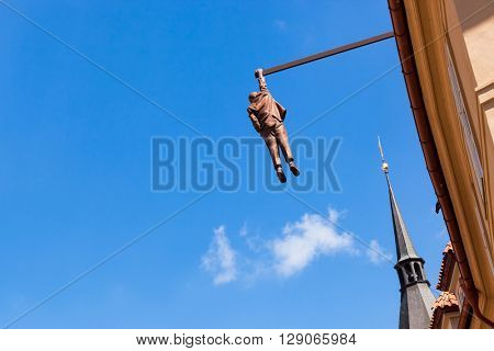 PRAGUE, CZECH REPUBLIC - APRIL 28, 2016 : Statue of Sigmund Freud hanging by one hand by David Cerny.  His works can be seen in many locations in Prague