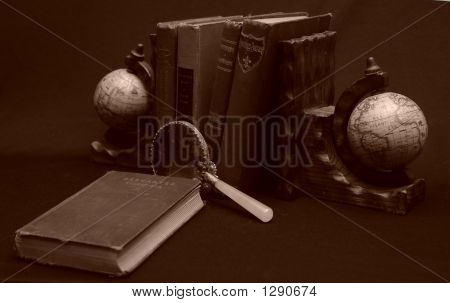 Books With Magnifying Glas And Globes