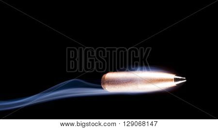 Copper plated bullet that has a polymer tip with smoke behind