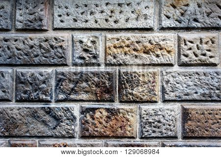 sandstone cladded wall for background or texture