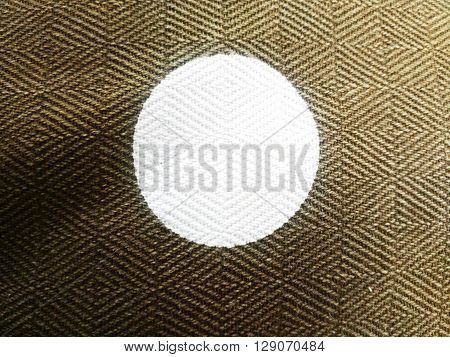 white dot pattern on brown polyester  fabric