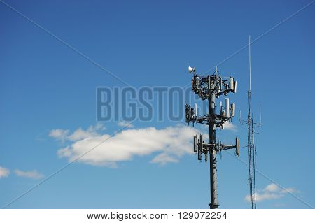 communication tower and antenna against blue sky