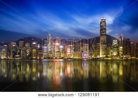 Victoria harbour skyline at night in Hong Kong Duo color tone