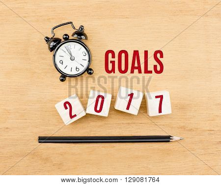 Goals 2017 Year On Wood Cube With Pencil And Clock Top View On Wood Table,new Year Business Concept