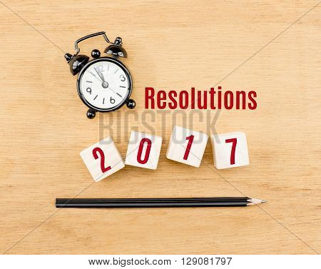 Resolutions 2017 Year On Wood Cube With Pencil And Clock Top View On Wood Table,new Year Business Co