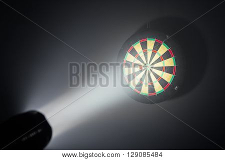 darts board illuminated with a spotlight