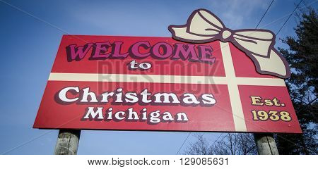 Munising, Michigan, USA - May 7, 2016: Welcome sign to the village of Christmas in Michigan's Upper Peninsula. The small town is located on the shores of Lake Superior and features street names such as Reindeer Run and Jingle Bell Lane.