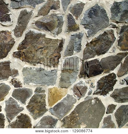 Stone texture wallpaper made of different shaped stones