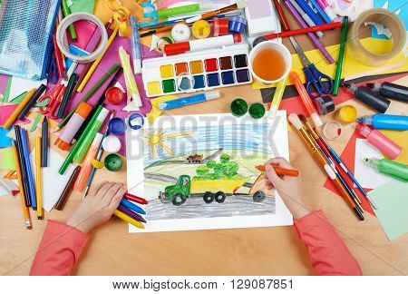 harvesting, truck with vegetables goes off field, dog driver, agriculture concept, child drawing, top view hands with pencil painting picture on paper, artwork workplace