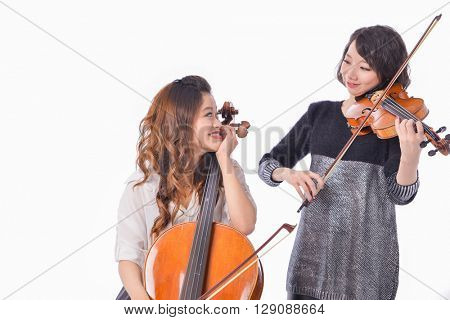 Two Beautiful young woman is playing the violin