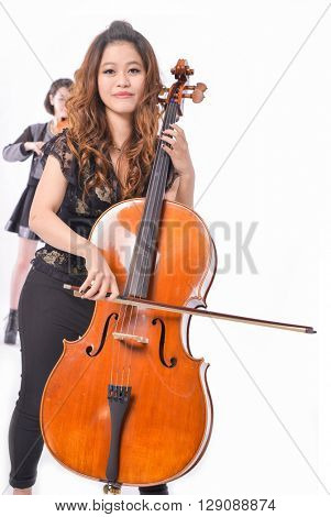 Two female musical player against white background