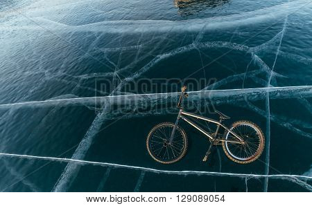 Bmx lies on the starkly beautiful and dangerous ice.