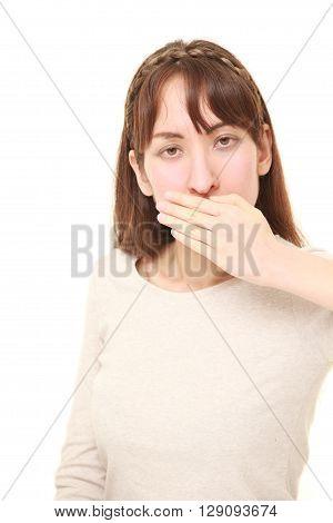woman making the speak no evil gesture