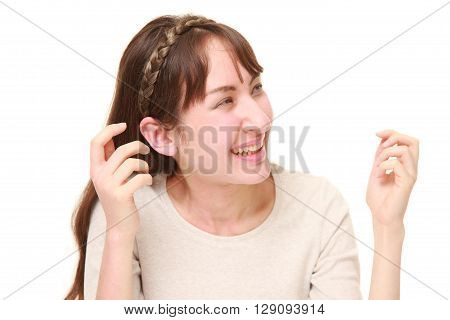 portrait of young woman laughing on white background