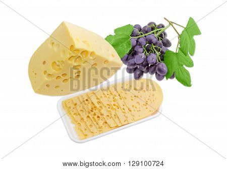 One piece several thin slices of the Swiss cheese with cheese's eyes on a plastic tray and bunch of blue grapes on a light background