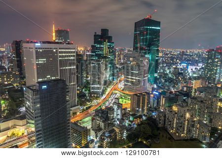 A shot from one of the high rises building in Tokyo which focuses on the illuminated expressway