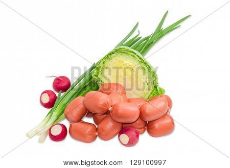 Bunch of uncooked short thick wieners with natural casings tied with twine several stalks of green onion red radish and young white cabbage on a light background