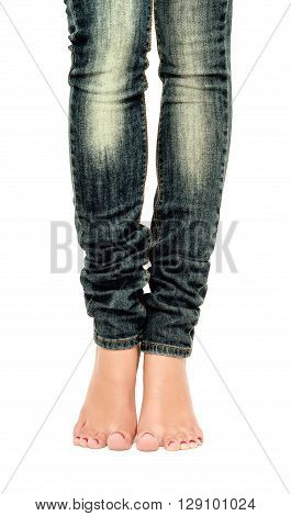 Female feet in jeans, closeup, isolated on white background