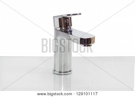 Single handle mixer with indicator as red-blue arrows on a reflective surface on a light background