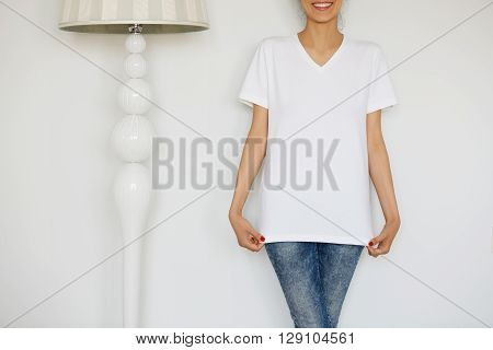 Close Up Of Cute Caucasian Teenage Redhead Girl In Blank White T-shirt For Your Text Message Or Adve