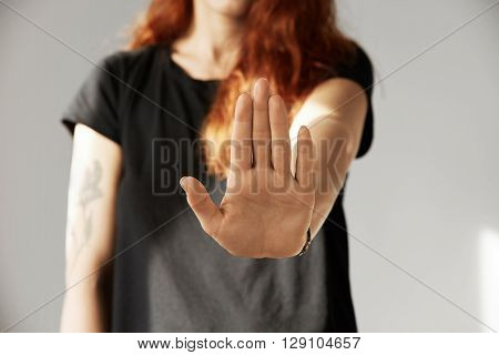 Cropped Isolated View Of Young Woman With Red Hair Making Stop Gesture With Her Palm. Portrait Of Te
