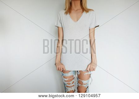 Portrait Of Attractive Blond Female Teenager Posing Wearing New Trendy Ripped Jeans After Shopping W