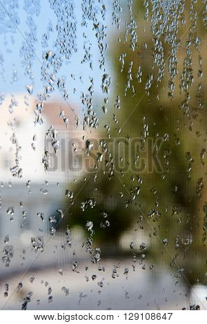 Condensation on a window pane with blurry background