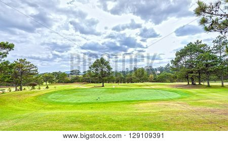 Centre hole golf course on Da lat hills to green grass beautifully decorated pine forests interspersed create fresh beauty attracts tourists to this resort in Lam Dong, Vietnam