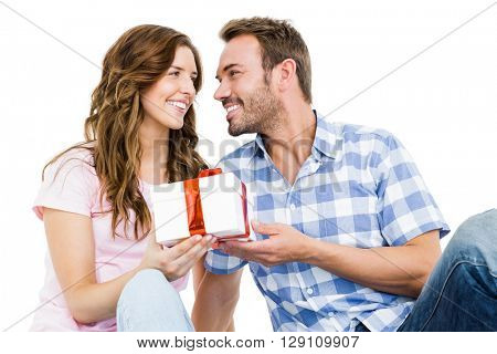 Man giving a gift to his woman on white background