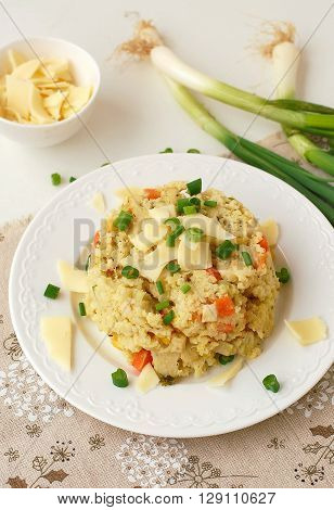 Millets With Vegetables, Spring Onion And Cheese