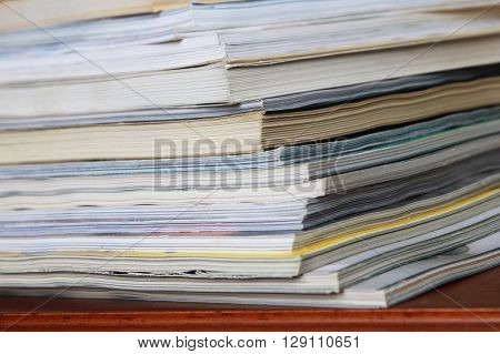 Stack of magazines - close up view of magazines on table