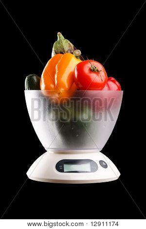 vegetables  on a  kitchen scale