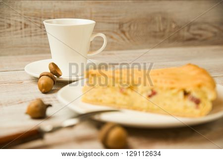 Cheese cake and a cup on the table