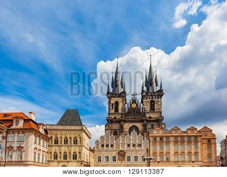 Old Town of Prague buildings, Czech Republic. View on Tyn Church and historic colorful tenement houses, blue sky.