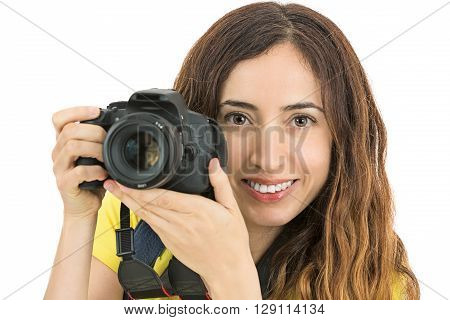 Attractive woman photographer holding her digital camera and smiling
