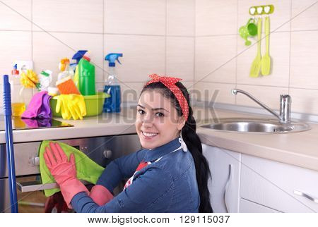 Cleaning Lady Wiping Oven