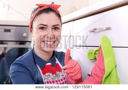 Woman Wiping Kitchen Drawers