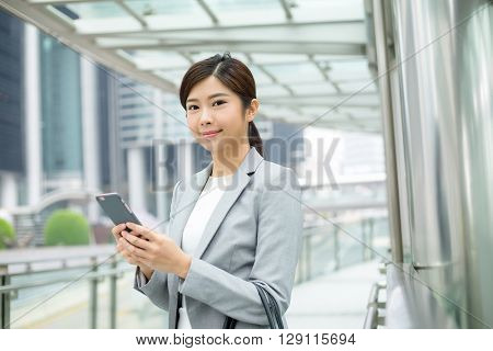 Business woman read on mobile phone